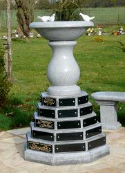 Birdbath with memorial plaques