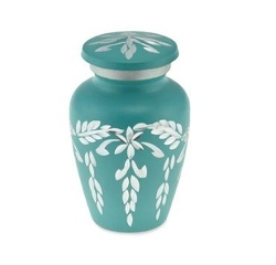 Urn made from aluminium in a teal colour with silver decoration