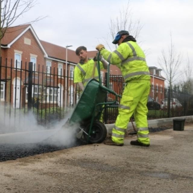 Reading Borough Council staff laying tarmac