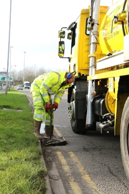 Member of the commercial services team carrying out drainage work