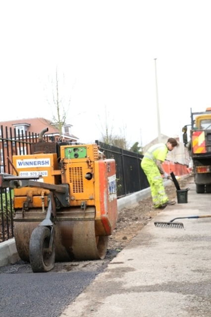 Reading Borough Council staff rolling out tarmac