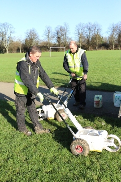 Commercial services team cutting grass
