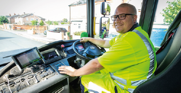 Trade waste operative at RBC behind the wheel of vehicle