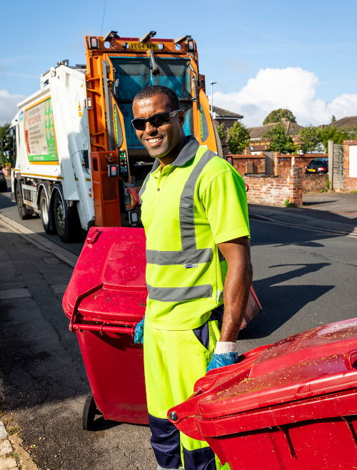 REfuse worker collecting recycling bins