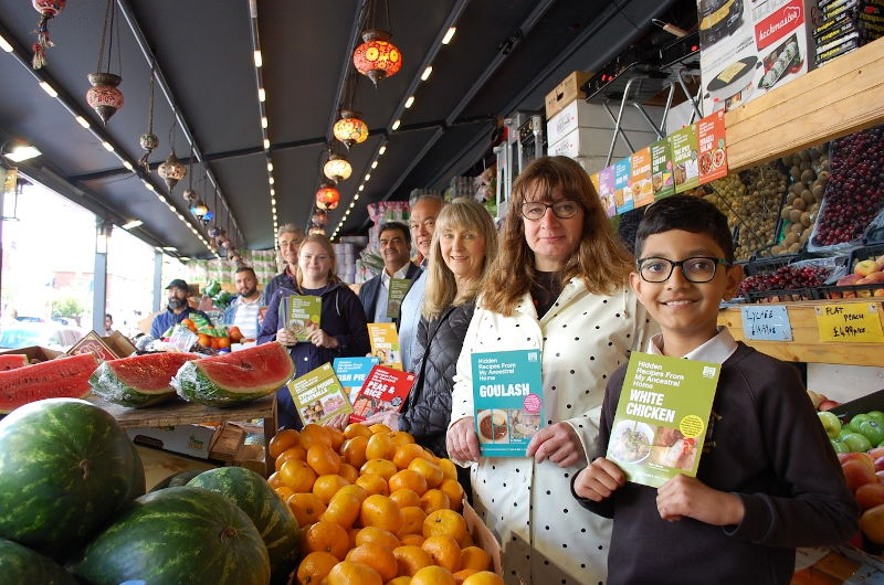 Caroline at the launch of her project; with local Cllrs, local residents who contributed recipes and staff from the Turkish Halal Food Centre, Oxford Road