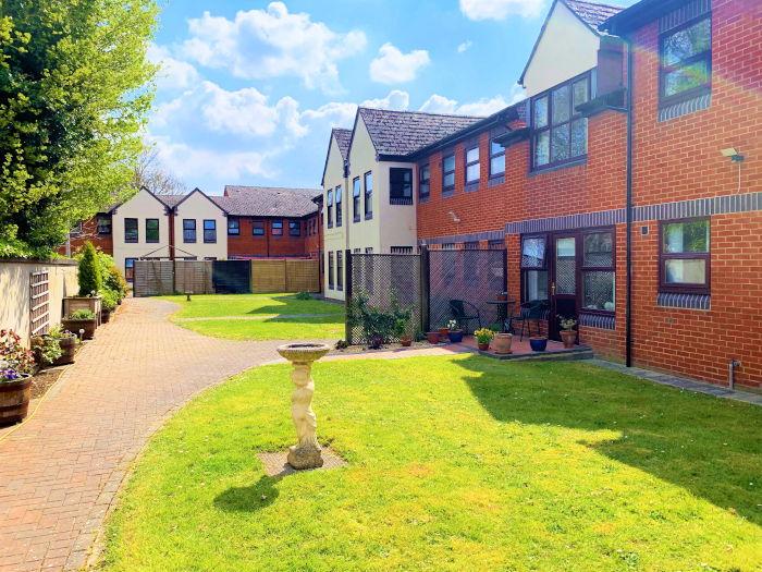 Bristow Court sheltered housing communal gardens with birdbath